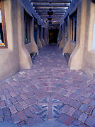 Brick walkway to store fronts in Old Town of Albuquerque, New Mexico.