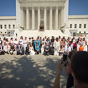 Twenty-five gay couples traveled to Washington on the C-Bus of Love to get married en masse in front of the Supreme Court of the United States, on June 21, 2013.  John Boal photography