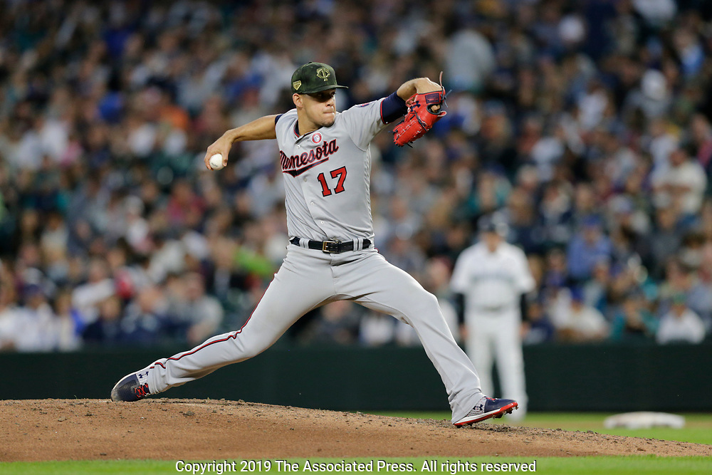 Minnesota Twins starting pitcher Jose Berrios works against the Seattle Mariners during a baseball game, Saturday, May 18, 2019, in Seattle. (AP Photo/John Froschauer)