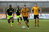 Mark O'Brien of Newport county © is chased by Uche Ikpeazu of Cambridge Utd (l) . The Emirates FA Cup, 2nd round match, Newport County v Cambridge United at Rodney Parade in Newport, South Wales on Sunday 3rd December 2017.<br /> pic by Andrew Orchard,  Andrew Orchard sports photography.