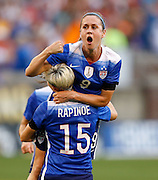 CHATTANOOGA, TN - AUGUST 19:  Midfielder Heather O'Reilly #9 of the United States (top) celebrates her goal with forward Megan Rapinoe #15 during the friendly match against Costa Rica at Finley Stadium on August 19, 2015 in Chattanooga, Tennessee.  (Photo by Mike Zarrilli/Getty Images)