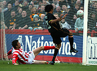 Photo. Chris Ratcliffe<br />Cheltenham v Hull. FA Cup Preliminary Round 08/10/2003<br />Jason price of hull scores to level the scores at 1-1.michael duff is the defender