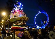 People are celebratingthe New Year in Westminster, near London Eye, in London.