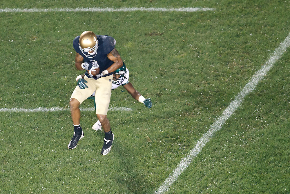 Notre Dame wide receiver Michael Floyd (#3) scores touchdown as South Florida safety JaQuez Jenkins (#30) defends in fourth action during NCAA football game between Notre Dame and South Florida.  The South Florida Bulls defeated the Notre Dame Fighting Irish 23-20 in game at Notre Dame Stadium in South Bend, Indiana.
