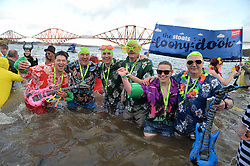 Loony Dookers Mathew Solway-Smith, Lawrie Warke, Kenny & John Solway, Jimmy Solway and Clair Monkhouse take part in the annual Loony Dook swim in the Firth of Forth on New Years Day.<br /> <br /> © Dave Johnston/ EEm