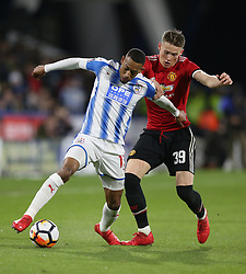Huddersfield Town's Rajiv van La Parra and Manchester United's Scott McTominay battle for the ball