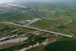 © Licensed to London News Pictures. 26/04/2016. Lydd, Romney Marsh, Kent, UK. Lydd (London Ashford Airport). Opened in July 1954 and formerly known as Ferryfield. The airport sees sees a mix of private and training general aviation, corporate jets and air taxis, cargo, maintenance as well as scheduled services to Le Touquet.  Photo credit: Martin Apps/LNP