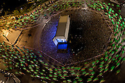 """26'000 people - all in similar green T-shirts takes part in the annual """"Midnattsloppet"""" - a 10km running race in central Stockholm, Sweden - hosted in the middle of the night in August every year since 1982."""