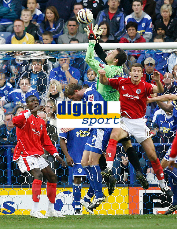 Photo: Steve Bond.<br />Leicester City v Barnsley. Coca Cola Championship. 27/10/2007. Keeper martin Fulop safely gathers under pressure from Stephen Foster (L)
