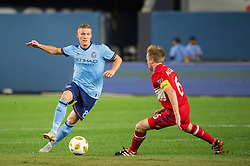 September 26, 2018 - Bronx, New York, US - New York City FC midfielder ALEXANDER RING (8) passes the ball defended by Chicago Fire midfielder DAX MCCARTY (6) during a regular season match at Yankee Stadium in Bronx, New York.  New York City FC defeats Chicago Fire 2 to 0 (Credit Image: © Mark Smith/ZUMA Wire)