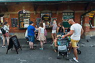 People order food at the rotunda in Plac Nowy, or New Square, in the Kazimierz Jewish quarter of Krakow, Poland. (August 28, 2016)