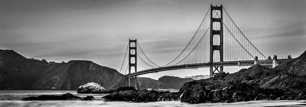 The Golden Gate Bridge in black and white as seen from Marshall Beach in San Francisco California.