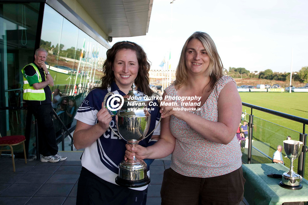 Meath Camogie Championship Finals Senior Final_12/9/09. Kilmessan v Trim <br /> Kilmessan Captain, Karen Ward accepts the cup from the Camogie Chairperson, Valerie Curtis after they defeated Trim in the Senior Final at Donaghmore Ashbourne GFC<br /> Photo: © David Mullen / www.quirke.ie