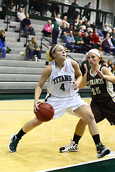 17 December 2011:  Brittany Hasselbring steps into the lane guarded by Cydney Weisflog during an NCAA womens division 3 basketball game between the St. Francis Fighting Saints and the Illinois Wesleyan Titans in Shirk Center, Bloomington IL