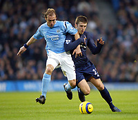 11/12/2004 - FA Barclays Premiership - Manchester City v Tottenham Hotspur - The City of Manchester Stadium.<br />Manchester City's Paul Bosvelt holds back Tottenham Hotspur's Michael Carrick<br />Photo:Jed Leicester/Back Page Images
