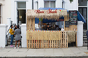 A makeshift Rum Shack during The Notting Hill Carnival on the 27th August 2018 in London in the United Kingdom. The Notting Hill Carnival is an annual event held over two days of the August Bank Holiday weekend. It has taken place in London since 1966 on the streets of Notting Hill, in the Royal Borough of Kensington and Chelsea and the City of Westminster.