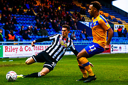Mark Ross of Chorley attempts to clear the ball from Nicky Maynard of Mansfield Town - Mandatory by-line: Ryan Crockett/JMP - 09/11/2019 - FOOTBALL - One Call Stadium - Mansfield, England - Mansfield Town v Chorley - Emirates FA Cup first round