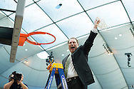 29 MAR 2015: Coach Tom Izzo of Michigan State University cuts down the net after their victory over the University of Louisville during the 2015 NCAA Men's Basketball Tournament held at the Carrier Dome in Syracuse, NY. Michigan State defeated Louisville 76-70 to advance. Brett Wilhelm/NCAA Photos