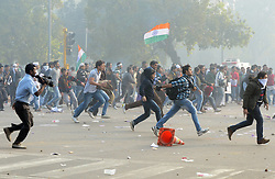 Protestors hurl stones during a demonstration at the India Gate in New Delhi, India, December 23, 2012. Photo by Imago / i-Images...UK ONLY