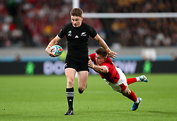 New Zealand's Beauden Barrett (left) is challenged by Wales' Josh Adams during the 2019 Rugby World Cup bronze final match at Tokyo Stadium.