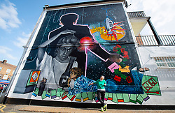 A 9 metre George Michael mural painted in Kingsbury by artist Dawn Mellor, North West London, Great Britain <br />Unveiled 17th September 2020    <br /><br />Artist Dawn Mellor looks up at her large-scale mural that celebrates the life of local hero George Michael who was a 1st year pupil at Kingsbury High School in 1974. <br />Commissioned as part of the Brent supported by the Brent Borough of Culture 2020 fund. <br /><br />Photograph by Elliott Franks