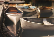 A moody tranquility of shapes and reflection, still water , contentment, and some excellent craftmanship among ordinary skiffs.