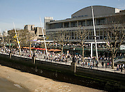 Crowds of people on the South Bank in front of the Royal Festival Hall, London