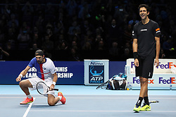 Poland's Lukasz Kubot (left) and Brazil's Marcelo Melo celebrate winning their doubles match during day two of the NITTO ATP World Tour Finals at the O2 Arena, London.