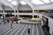 National coronavirus lockdown three begins at Grand Central in Birmingham city centre, which is deserted apart from a few people travelling on 6th January 2021 in Birmingham, United Kingdom. Following the recent surge in cases including the new variant of Covid-19, this nationwide lockdown, which is an effective Tier Five, came into operation today, with all citizens to follow the message to stay at home, protect the NHS and save lives.