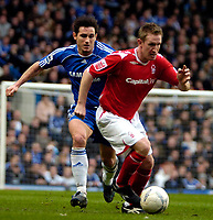 Photo: Ed Godden/Sportsbeat Images.<br /> Chelsea v Nottingham Forest. The FA Cup. 28/01/2007.<br /> Forest's John Curtis is followed by Frank Lampard.