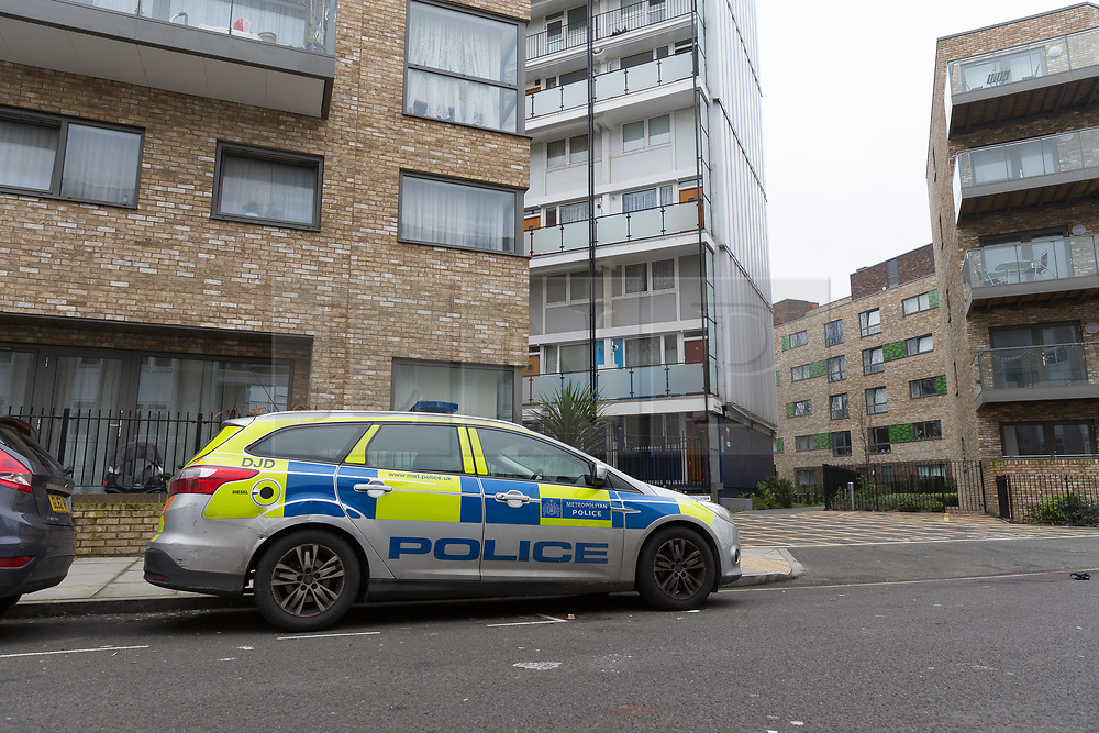 © Licensed to London News Pictures. 13/04/2018. London, UK. A police car on the street outside Galleon House, Manchester Road on the Isle of Dogs in Tower Hamlets. A man in his 30's was found injured from a stab wound yesterday morning and died at the scene. A woman, Alex Glanfield-Collis, of Manchester Road has been charged with murder, to appear at Thames Magistrates Court this morning. Photo credit: Vickie Flores/LNP