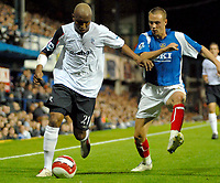 Photo: Ed Godden.<br /> Portsmouth v Bolton Wanderers. The Barclays Premiership. 25/09/2006. El-Hadji Diouf (L) is followed by Portsmouth's  Matthew Taylor.