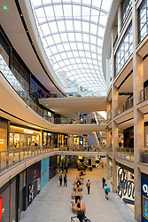 Interior view of atrium inside new St James Quarter shopping mall in Edinburgh, Scotland, UK