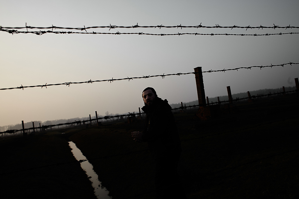 """Poland, Concentration Camp Auschwitz 2013/02/28<br /> <br /> Shimon Walles, who descrobes himself as modern orthodox, visits the Concentration Camp Auschwitz where many of his family were deported to during the war. After living in Germany for about a year, Shimon Walles, originally from Melbourne, Australia, left Germany for Israel. As he states: """"In Germany I felt that my Judaism was in jeopardy, here in Israel I feel like a fish in water.""""<br /> <br /> Jewish life in Germany occurs in a myriad of ways – being Jewish is just as much a question of identity as it is one of religion. The Jewish community in Germany is however fairly small, official numbers state that only about 96.000 Jews live in the country. Often only perceived through debates of anti-semitism and holocaust commemorations and displayed in the media in a stereotypical way, I aim to explore everyday life of contemporary Judaism in Germany in all its facets and diversity. (Photo by Gregor Zielke)"""