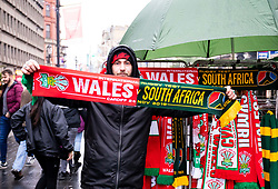 A flag seller outside of the stadium<br /> <br /> Photographer Simon King/Replay Images<br /> <br /> Under Armour Series - Wales v South Africa - Saturday 24th November 2018 - Principality Stadium - Cardiff<br /> <br /> World Copyright © Replay Images . All rights reserved. info@replayimages.co.uk - http://replayimages.co.uk
