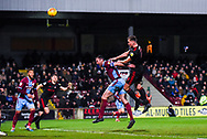 Charlie Wyke of Sunderland (9) rises above Rory McArdle of Scunthorpe United (23) to head the ball over during the EFL Sky Bet League 1 match between Scunthorpe United and Sunderland at Glanford Park, Scunthorpe, England on 19 January 2019.