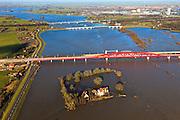Nederland, Gelderland, Hattem, 20-01-2011; bruggen over IJssel bij hoogwater met IJsselstein geïsoleerd door het hoogwater. De bruggen zijn: de rode spoorbrug van de Hanzelijn, de spoorbug van de bestaande spoorlijn, de IJsselbrug (boogbrug), de verkeersbrug voor de A28. Zwolle-Zuid in de achtergrond..Three (3) bridges on the river IJssel near Zwolle. The IJsselstein Mansion has been isolated by the high water of the river..luchtfoto (toeslag), aerial photo (additional fee required).copyright foto/photo Siebe Swart