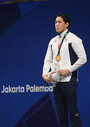 JAKARTA, Aug. 24, 2018  Gold medalist Koseki Yasuhiro of Japan attends the awarding ceremony after men's 50m breaststroke final of swimming at the 18th Asian Games in Jakarta, Indonesia, Aug. 24, 2018. (Credit Image: © Pan Yulong/Xinhua via ZUMA Wire)