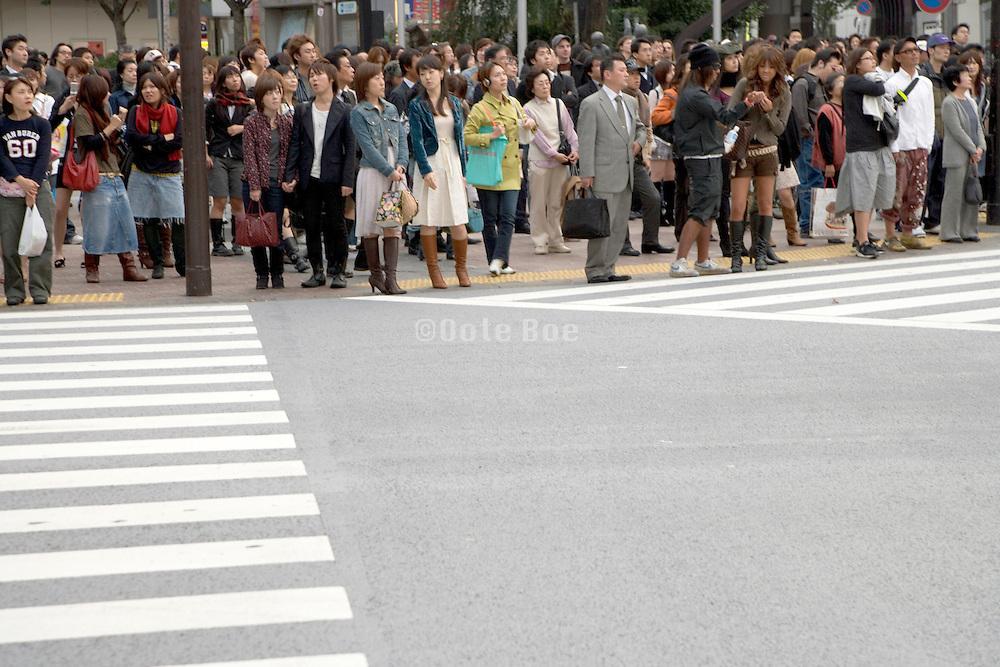 crowd waiting to cross the street Tokyo Japan