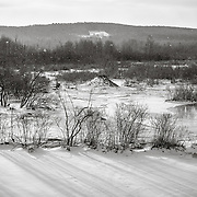 East Branch Housatonic River, Hinsdale, MA with beaver hut in frozen river.