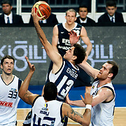 Fenerbahce's Marko TOMAS (L), Oguz SAVAS (R) and Efes Pilsen's Ender ARSLAN (C) during their Turkish Basketball Legague Play-Off semi final first match Fenerbahce between Efes Pilsen at the Sinan Erdem Arena in Istanbul Turkey on Tuesday 24 May 2011. Photo by TURKPIX