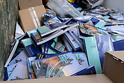 Printed tourism booklets from the London Pass ticketing organisation await collection by a waste contractor, to be recycled in a West End lorry on 29th September 2020, in London, Westminster, England. In future, this literature is to be published digitally by London Pass, rather than remaining in physical form. The London Pass is a digital sightseeing pass that gives visitors to London access to 80+ attractions in the city.