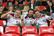 three England fans cheering before k/o. England v Spain, Football international friendly at Wembley Stadium in London on Tuesday 15th November 2016.<br /> pic by John Patrick Fletcher, Andrew Orchard sports photography.
