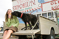 A young woman eats ice cream with her dog at the Victor Emporium in Victor, Idaho.