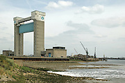 Clean water flows into the Thames from the northern outfall of Beckton Sewage TreatmentWorks. Sewage from 3.4 million Londoners is treated on site every day. Barking Creek Tidal Barrier, which resembles a giant guillotine, was built over four years and completed in 1983. It is about 60m high, which allows shipping to reach the Town Quay in Barking further upstream. The barrier crosses the Barking Creek reach of the River Roding at its confluence with the Thames. London, UK, 2003