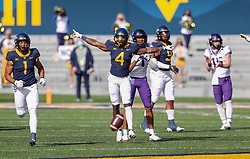 Nov 14, 2020; Morgantown, West Virginia, USA; West Virginia Mountaineers cornerback Alonzo Addae (4) celebrates after a defensive stop during the first quarter against the TCU Horned Frogs at Mountaineer Field at Milan Puskar Stadium. Mandatory Credit: Ben Queen-USA TODAY Sports