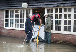 © Licensed to London News Pictures. 21/12/2019. Pulborough, UK. The River Arun has burst its banks and flooded local businesses in Pulborough, West Sussex. River levels remain high after heavy overnight rain in the south where more rain is expected today. Photo credit: Peter Macdiarmid/LNP
