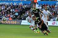 John Terry of Chelsea heads clear from Jack Cork of Swansea city.Premier league match, Swansea city v Chelsea at the Liberty Stadium in Swansea, South Wales on Sunday 11th Sept 2016.<br /> pic by  Andrew Orchard, Andrew Orchard sports photography.