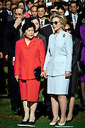 US First lady Hillary Clinton with Lao An, wife of Chinese Premier Zhu Rongji during the official arrival ceremony at the White House April 8, 1999 in Washington D.C.