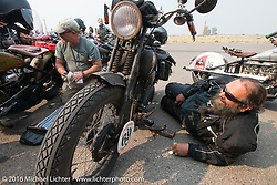 Dave Kafton working on his 1925 Harley-Davidson JD at a gas stop during Stage 13 (257 miles) of the Motorcycle Cannonball Cross-Country Endurance Run, which on this day ran from Elko, NV to Meridian, Idaho, USA. Thursday, September 18, 2014.  Photography ©2014 Michael Lichter.
